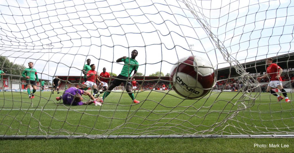 FC's Cedric Main slams home the opening goal against Enfield Town